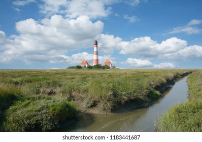 the famous Westerhever Lighthouse on Eiderstedt Peninsula in North Frisia,Schleswig-Holstein,Germany
