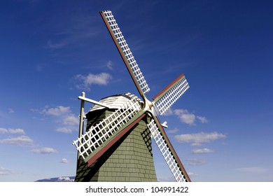 A famous wind mill replica of Holland with blue sky and white clouds