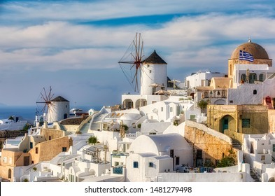 Famous Windmills in the Beautiful Village of Oia on Santorini, Greece