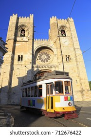 Famous yellow tram running in front of Se Cathedral in Lisbon, Portugal