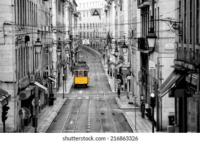 Famous yellow tram in the streets of Lisbon, capital of Portugal in the early morning with no people yet around in the center of the city