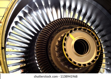 Fan blade hub and stator vane of turbine engine removed for maintenance and clean all part.Jet engine of airplane ( aircraft) remove fan blade from the hub.
