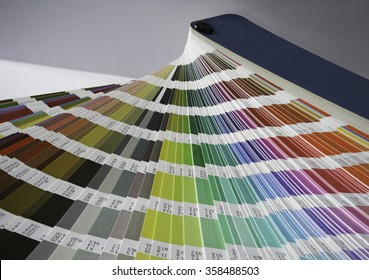 Fan of bright color swatches for color matching in printing and graphic design.