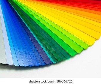 Fan of colorful adhesive vinyl. Isolated on white background.