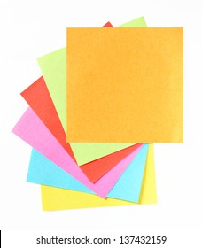 A fan of colorful post-it notes, white background