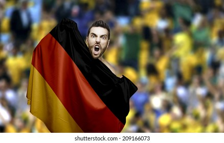 Fan holding the flag of Germany celebrates in the stadium