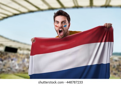 Fan holding the flag of Netherlands