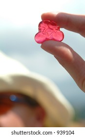 A fan holds up a cycling candy - 2004 Tour de France
