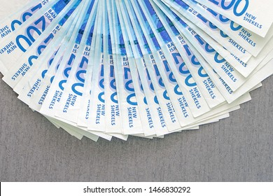 Fan of New Israeli Shekel series C. Israeli money notes isolated on gray background. Textures. Close-up.