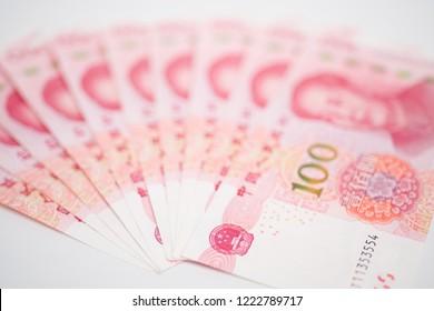 Fan shape of 100 yuan china banknotes focus on national emblem