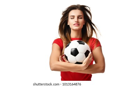 Fan sport woman player in red uniform hold soccer ball celebrating with windy hair and free text copy space isolated on white background