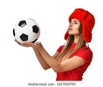 Fan sport woman player in red uniform hold soccer ball on head celebrating with windy hair and free text copy space isolated on white background