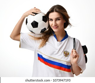 Fan sport woman player in russian uniform hold soccer ball and boots celebrating on white background