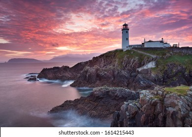 Fanad Head, co. Donegal / Ireland - October 2018 : Sunrise time on Fanad Head peninsula with Fanad lighthouse at the background along Wild Atlantic Way