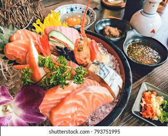 Fanciful serving dish of Mixed Sashimi on ice. Sashimi salmon set with prawn in Japanese  restaurant.