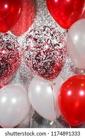 fancy balloons. Closed up of helium balloons in red and white concept for indoor party celebration or special occasions like birthday. Selective focus.