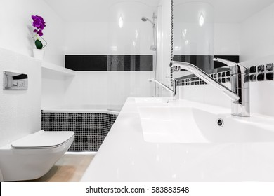 Fancy bathroom interior with two white classical washbasins and faucets