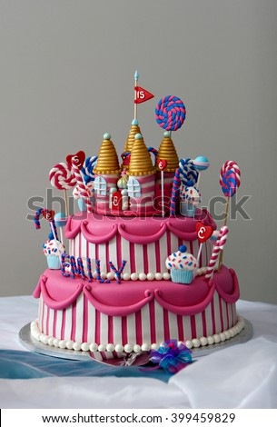 A Fancy Birthday Cake With Candyland Theme The Three Layer Is Covered