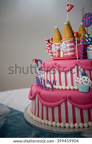 A Fancy Birthday Cake With Candyland Theme The Three Layer Is Covered Fondant And Candy Decorations