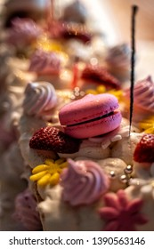Fancy bithday cake with strawberries and candies. blurred background