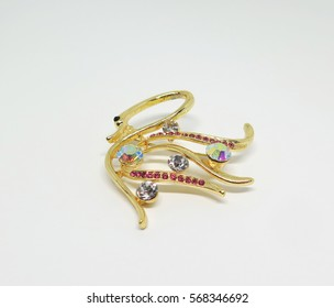 Fancy brooch with colorful gems in swan shape with white background,