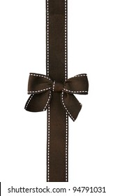 Fancy brown ribbon gift bow with white stitching on white background