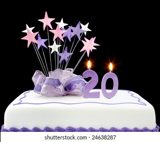 Fancy Cake With Number 20 Candles Decorated Ribbons And Star Shapes In