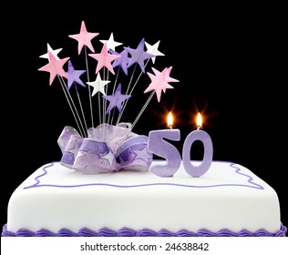 Fancy Cake With Number 50 Candles Decorated Ribbons And Star Shapes In