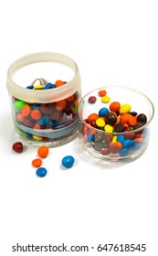 Fancy candy in the glass jar with white background