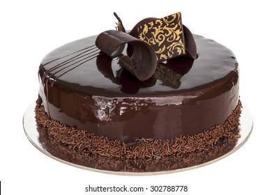 Fancy chocolate cake, whole, isolated on white background.