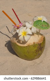 Fancy cocktail on the beach, flowers in coconuts