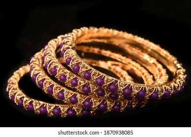 Fancy Designer Bracelets Bangles Jewelry closeup Macro image on Black Background