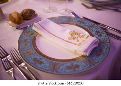 Fancy dinner place setting for parties, Blue and gold plates, Proper etiquette for the dinner table, High standards party decor