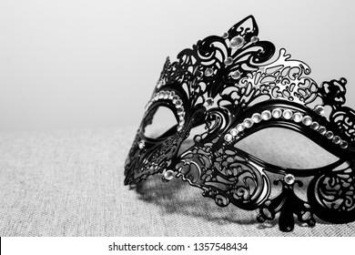Fancy elegant black and white masquerade mask with rhinestone embelishment.