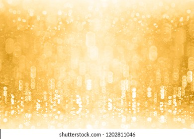 Fancy glitzy gold glitter sparkle confetti background for golden happy birthday party invite, 50 wedding anniversary, fun music dance club, winter Christmas or New Year's Eve champagne bubbles texture