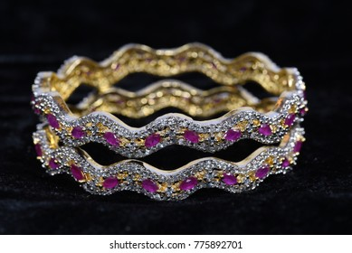 Fancy Gold looking Bracelet with Diamond macro images and black background