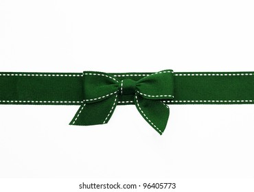 Fancy green ribbon gift bow with white stitching on white background