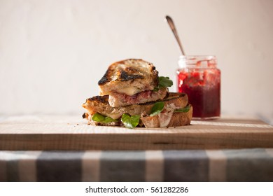 Fancy Grilled Cheese next to a jar of cherry jam