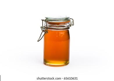 Fancy jar of golden honey on white, isolating background