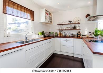 fancy kitchen interior with dark wooden floor and wooden counter top