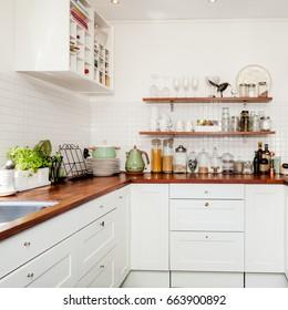 fancy kitchen interior wooden counter top with kitchen utensils