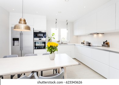 fancy kitchen interior with yellow roses on the table
