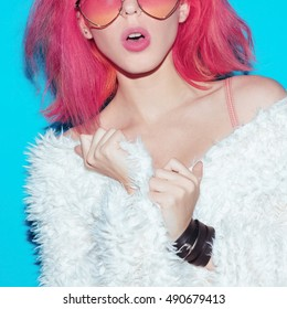 Fancy Lady. Stylish pink Hair, glamorous coat, Pink Sunglasses. Club style