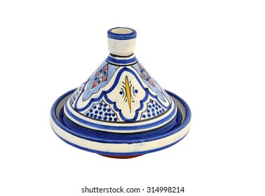 Fancy painted tagine pot from Morocco on a white background.