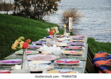 A fancy picnic table by lake