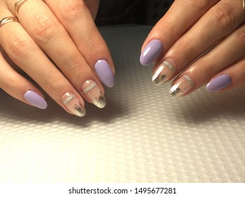 fancy purple manicure with silver ribbon and foil on a textured background