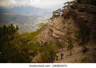 Fancy rocks. Mountain AI-Petri. View of Yalta and the sea. The Rocks Of Taraktash. People walk along the path. Crimea.
