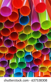 Fancy straw art background. Abstract wallpaper of colored fancy straws. Rainbow colored colorful pattern texture. Party concept studio photo of mixed  fancy straws.