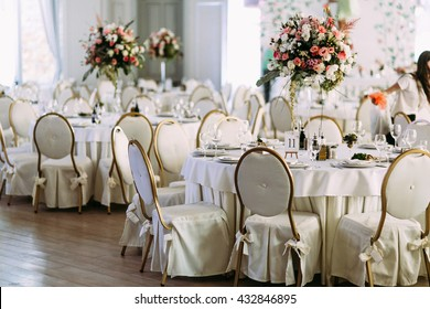 Fancy tables with the bouquets of flowers