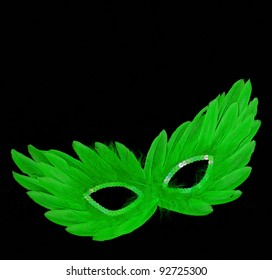 Fancy Vintage Festive Green Feathers with Sequin dress mask isolated on black velvet background
